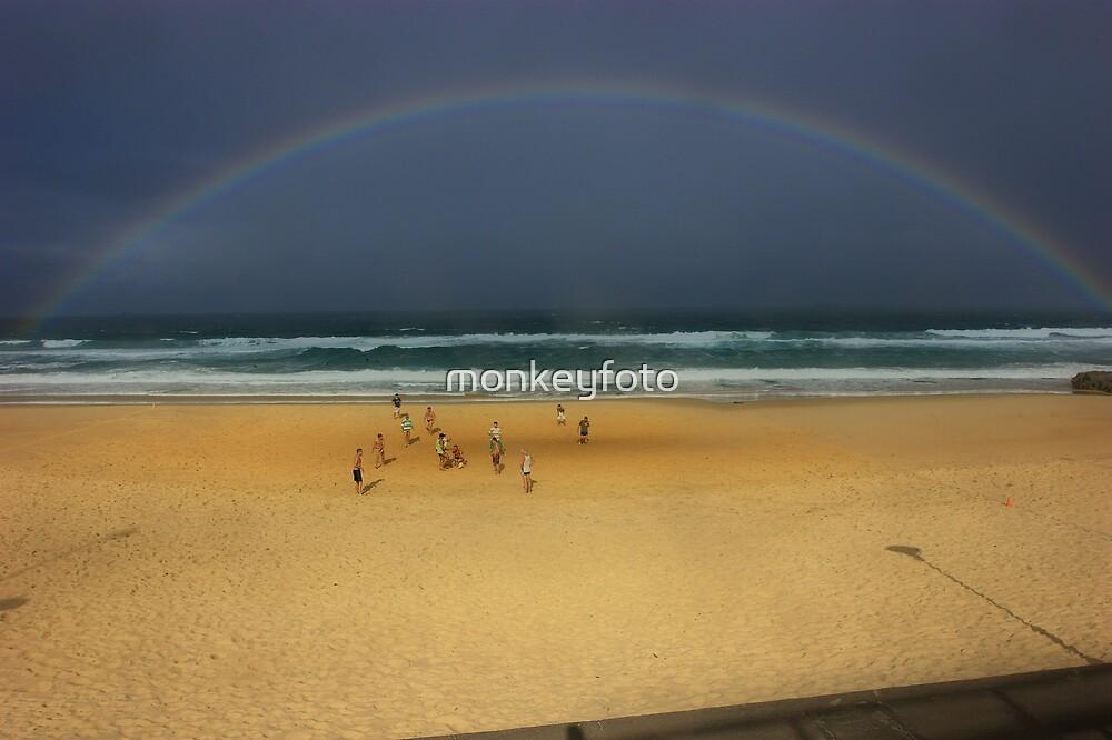 Beach Footy Under a Rainbow by monkeyfoto