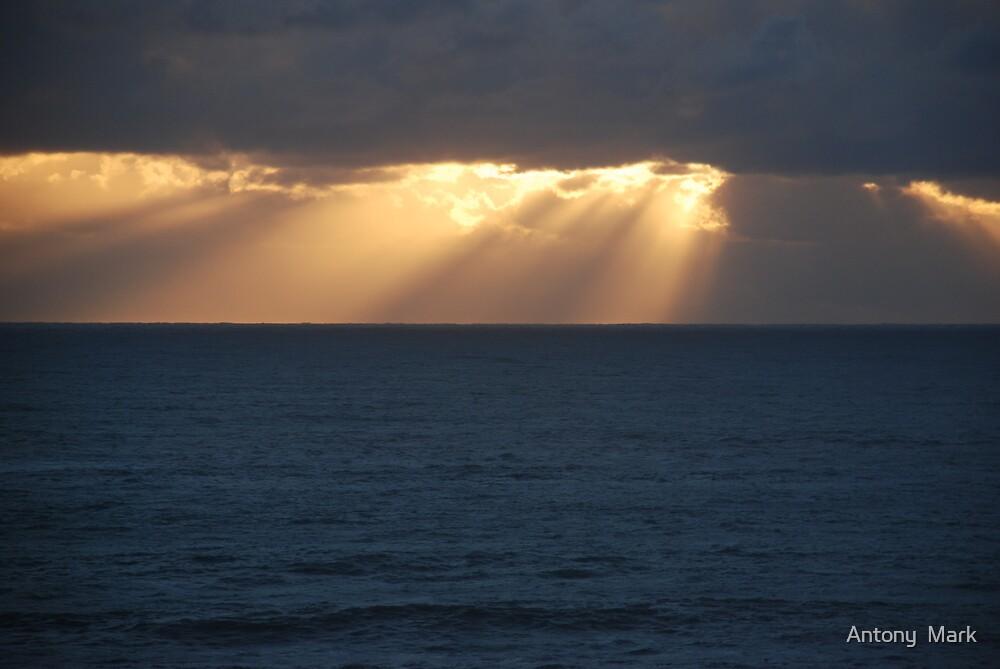 Sunset upon dark sea by Antony  Mark