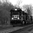 A train coming to you in black and white by jammingene