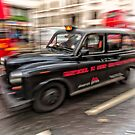 London Cab in motion by photograham
