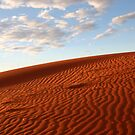 Warm red sand dune by Keiran Lusk