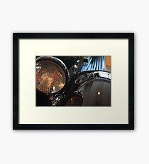 Close up on black shining car round light Framed Print