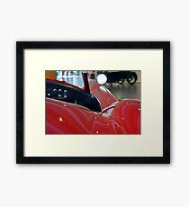 Close up on red sport car Framed Print
