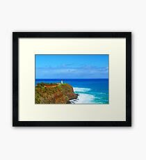 lighthouse on the green mountain with blue ocean and blue sky view at Kauai, Hawaii, USA Framed Print