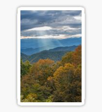 Sunbeams shine through the clouds to the mountains Sticker