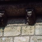 Carvings on Beam ends in Chapel walls Caen 19840819 0080 by Fred Mitchell