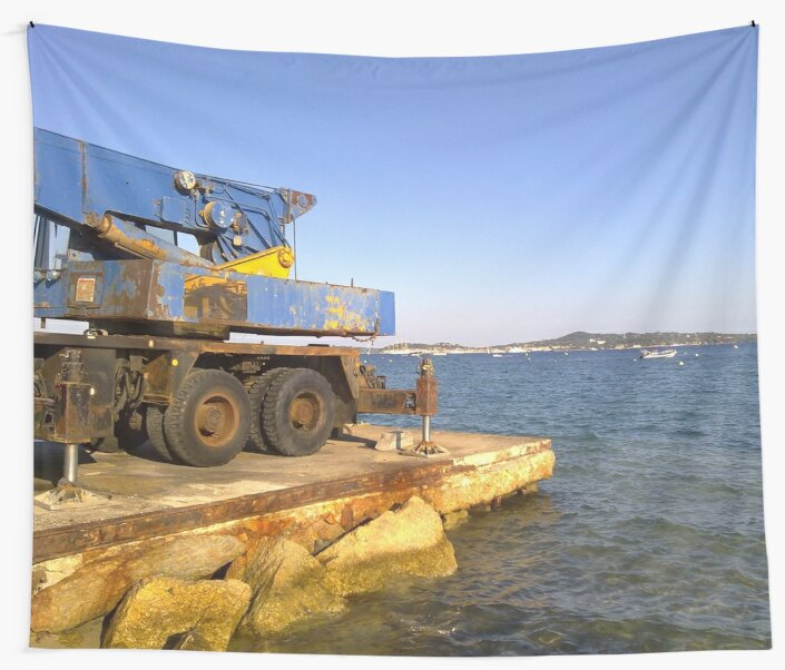 Old crane at the beach of Grimaud, opposite of St. Tropez. by Robert Elfferich