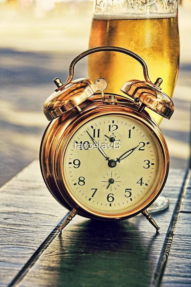 Vintage alarm clock and beer glass. by IaroslavB