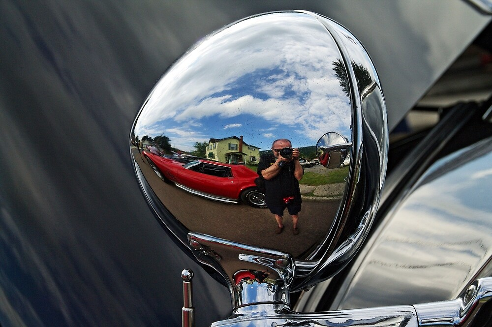 Car mirror reflection by Karl Rose