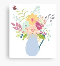 Enamel jug full to overflowing with flowers Canvas Print