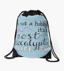 Knitting is a life skill Drawstring Bag