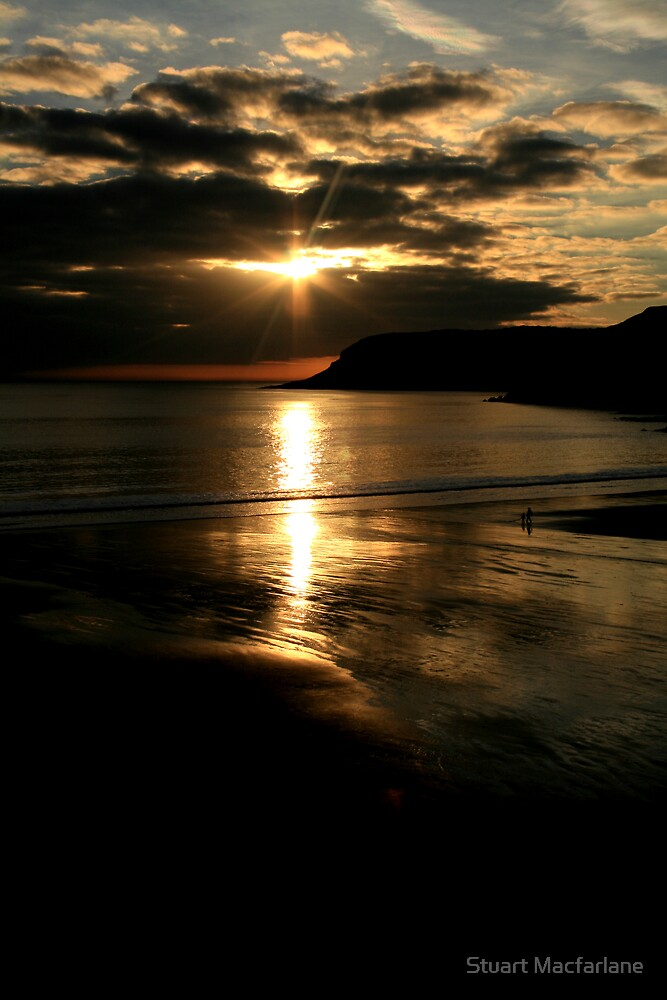 Sunset over Caswell by Stuart Macfarlane