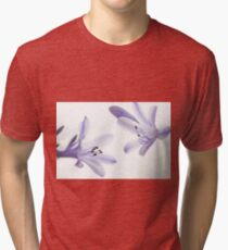 Soft selective focus of a dreamy white flower  Tri-blend T-Shirt