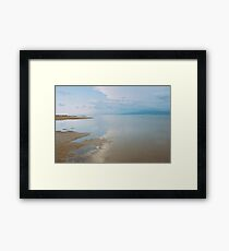A peaceful scene of a calm sea and sunset Framed Print