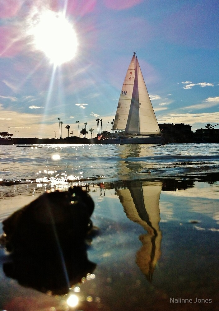 White Sailboat Reflecting in the Sparkling Glassy Water by Nalinne Jones