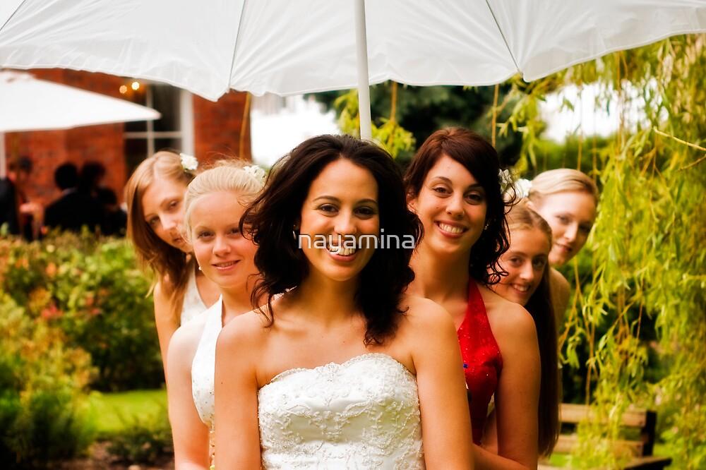 Bride with bridesmaids fanning out by nayamina