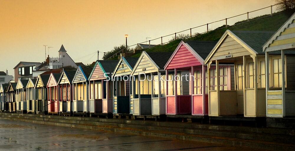 Wet beach Huts by Simon Duckworth