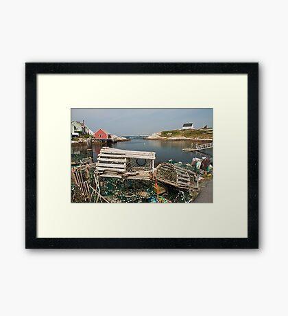 Peggy's cove through a lobster trap Framed Print
