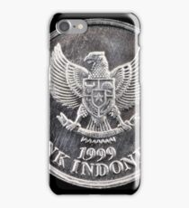 Indonesian coin close up on a black background iPhone Case/Skin