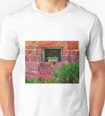 Sunset light on the old barn wall T-Shirt