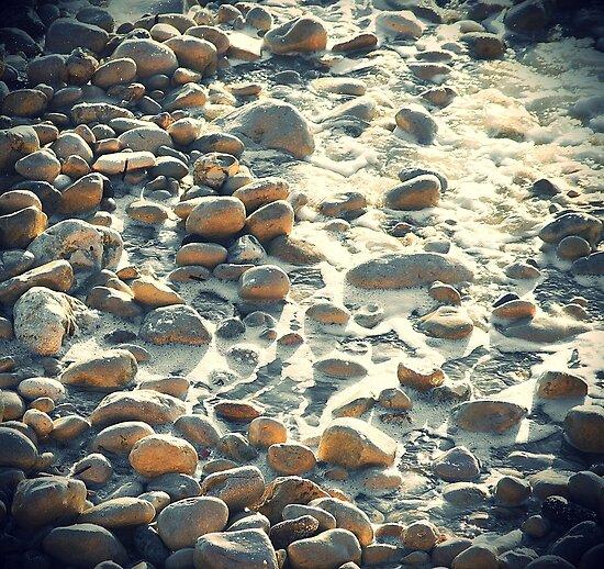 Beach pebbles under a hot sun by SimonWake