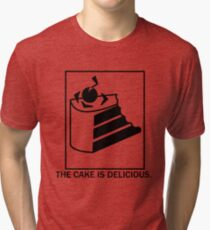 The cake is delicious. Tri-blend T-Shirt