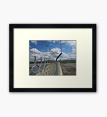 Barbed wire and sky Framed Print