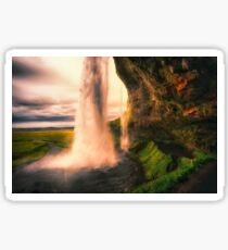 View of the Seljalandsfoss Waterfall Behind from a Cave at Sunset, Iceland Sticker
