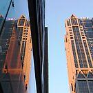 Dusk city reflection by Justin  Robertson