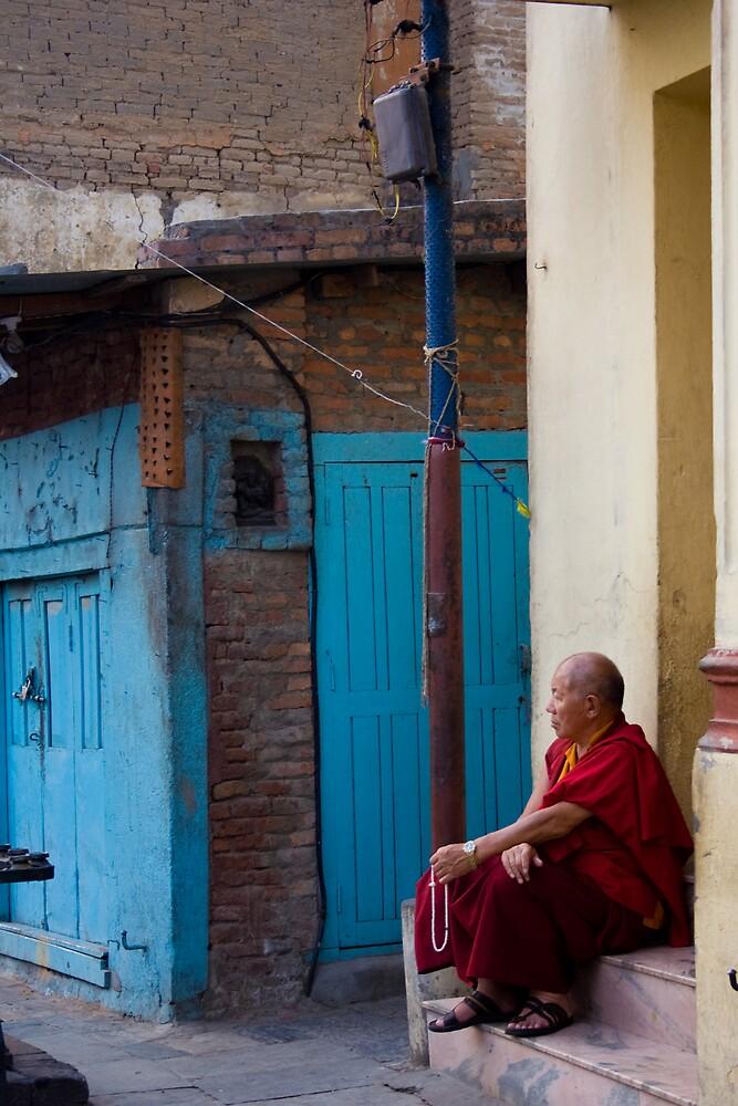 Buddhist monk at Swayambunath Temple by Olivier Lance