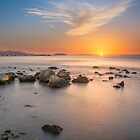 Sunrise on the rocks by Ralph Goldsmith