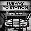 Dirty old Subway to Station sign on Flinders Street in the Melbourne central business district  by Adam Calaitzis