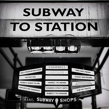 Dirty old Subway to Station sign on Flinders Street in the Melbourne central business district  by adamcal