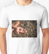 Heart in a child's hand T-Shirt