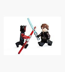 Lego Star Wars minifigure Anakin Skywalker and Darth Maul are fighting with sword isolated on white background. Photographic Print