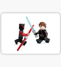 Lego Star Wars minifigure Anakin Skywalker and Darth Maul are fighting with sword isolated on white background. Sticker