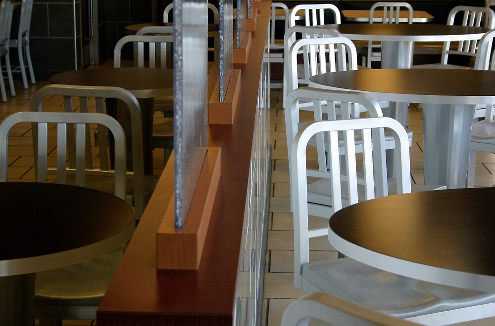Tables And Chairs Waiting For Customers by Cora Wandel