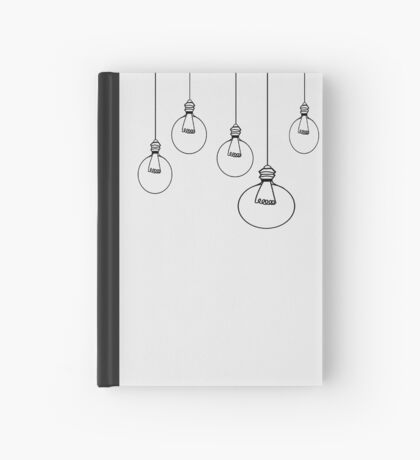 Light Bulbs on White Hardcover Journal
