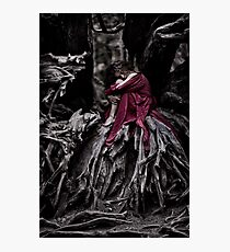 Woman in red dress curled up like a child in roots of an old dead tree art print Photographic Print