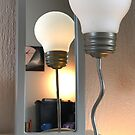 Reflection of a kingsize lightbulb by Arie Koene