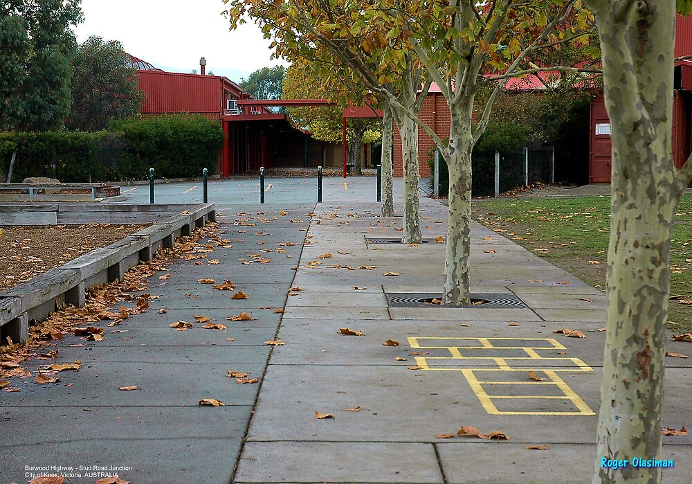 Falling leaves in the school yard. by Roger Olasiman