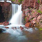 Redrocks Falls, Glacier National Park by Gary Lengyel