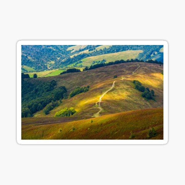 path down the grassy hillside to valley Sticker