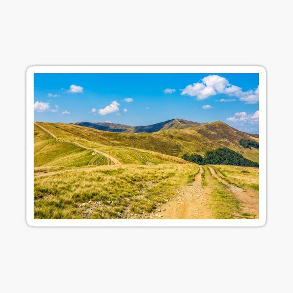 road through hilly ridge with peaks Sticker