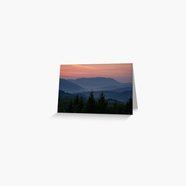 reddish sky at dawn in mountains Greeting Card