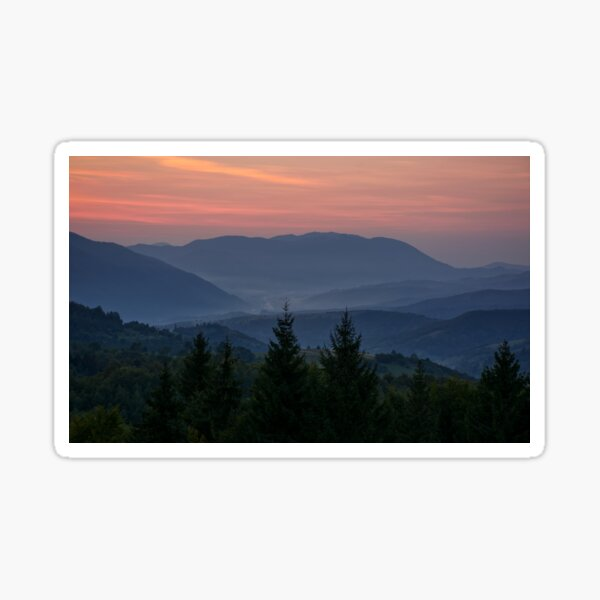 reddish sky at dawn in mountains Sticker