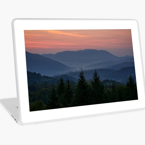 reddish sky at dawn in mountains Laptop Skin