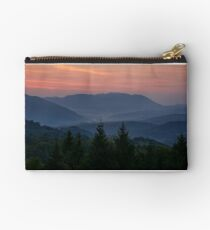 reddish sky at dawn in mountains Studio Pouch