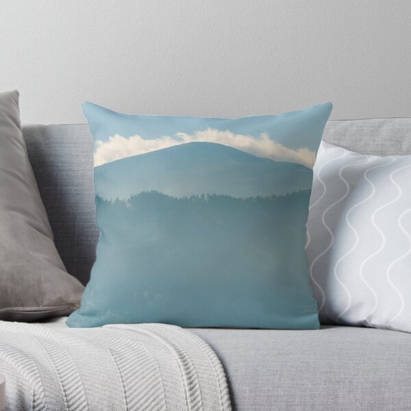 clouds rising behind the blue mountain Throw Pillow