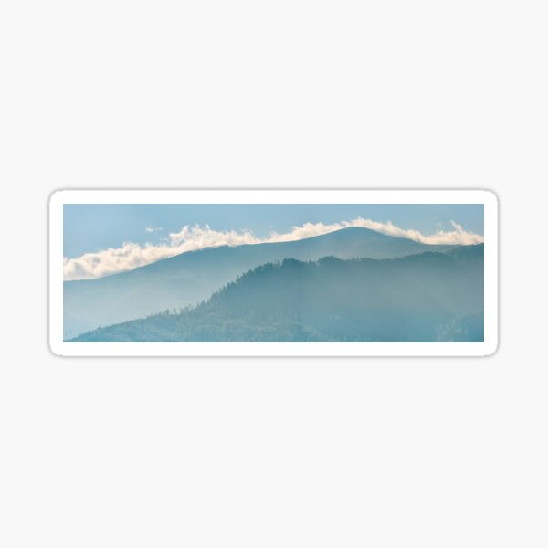 clouds rising behind the blue mountain Sticker